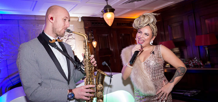 Uptown Collective saxofonist Tim & MC Emy Perez Richemont Christmas Party Amsterdam 2017